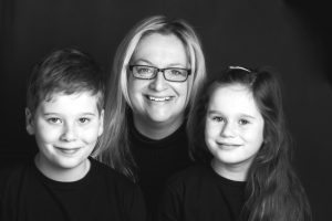 Black and white image of Erika Townend and her children