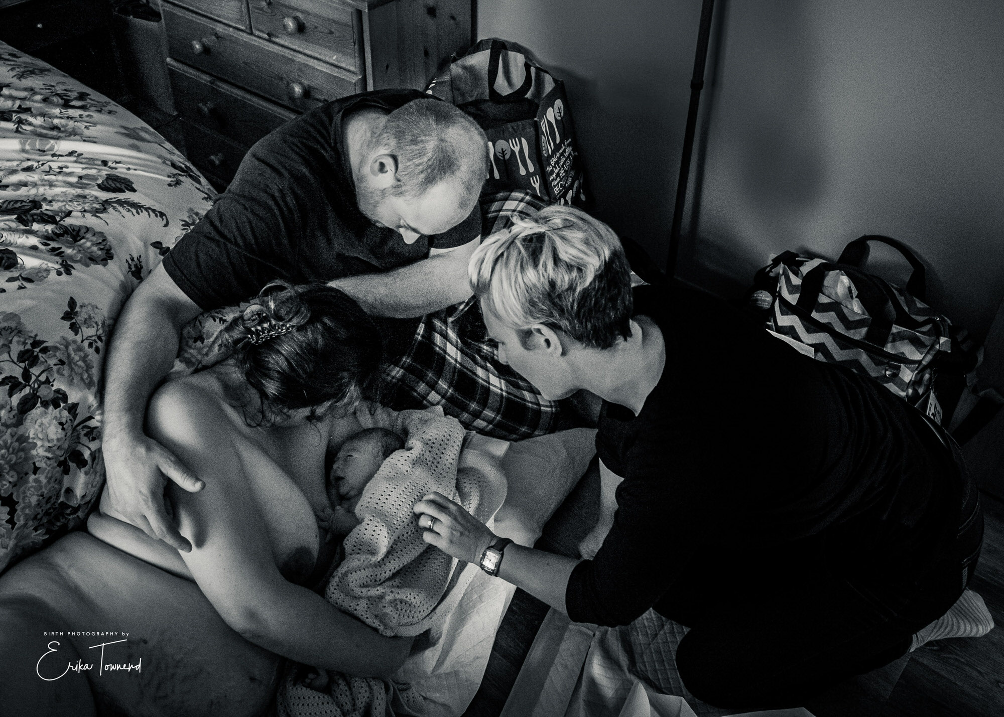 Black and white image of meeting their new baby after a homebirth with a midiwfe by Erika Townend Birth