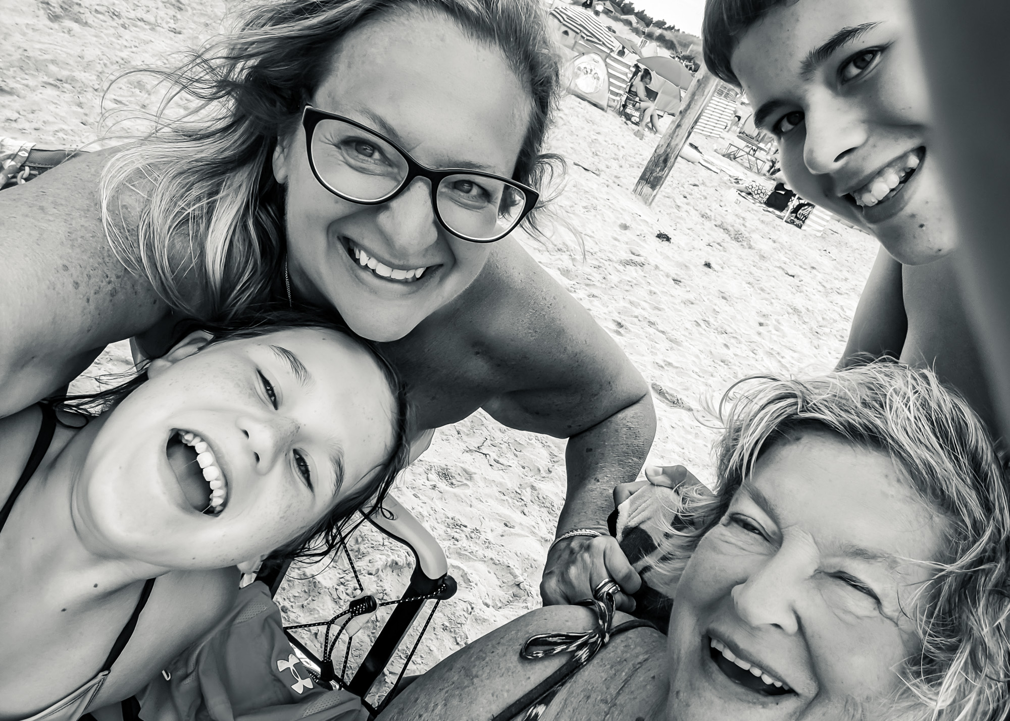 Black and white selfie of Erika enjoying life with family at the beach